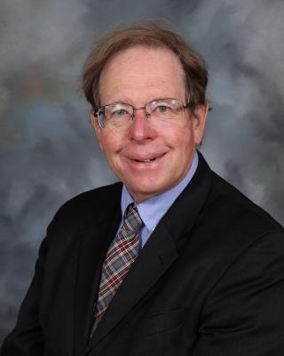 Dr. Alan Caroe